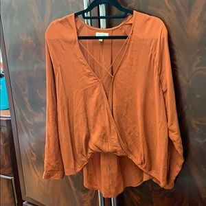 Burnt orange wrap front blouse